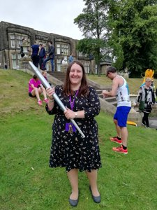 Heather Millard curator at Cliffe Castle Museum holding the 2018 Pyeongchang torch at the Incredible Me celebration day