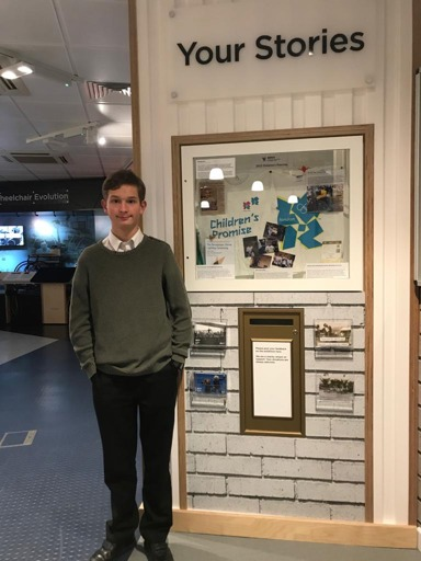 Daniel Bleasdale next to his 2012 Childrens Promise display in the Paralympic Heritage Centre
