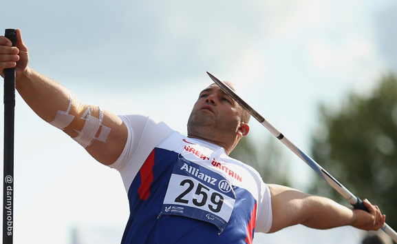 Danny Nobbs throwing the javelin