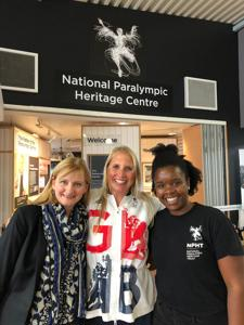 Vicky Hope-Walker, Stephanie Millward MBE and Elaine Phiri in front of the entrance to the National Paralympic Heritage Centre