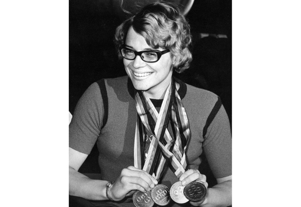 Black and white photo of Caz Walton and her winning medals at the 1972 Heidelberg Summer Paralympics