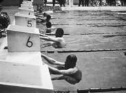 A video still of swimmers at the 1964 Tokyo Paralympics
