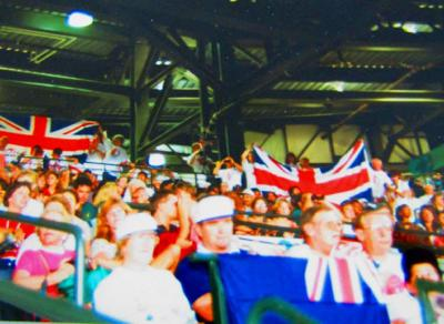 Spectators flying country flags at the 1996 Atlanta Paralympics