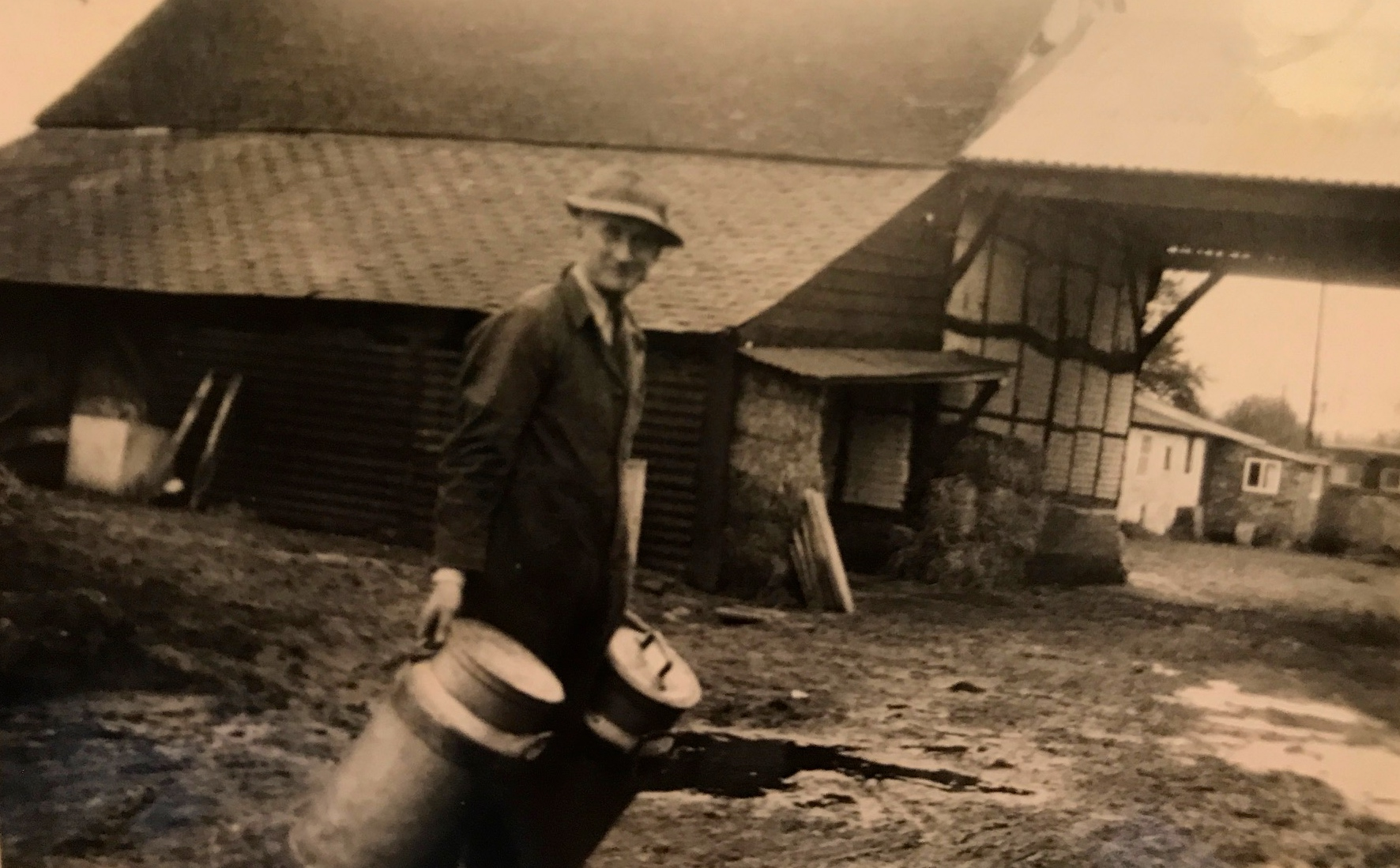 George Evered with milk pails collected for Nestle factory