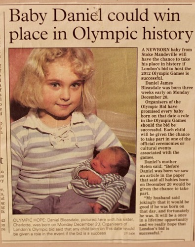 Newspaper article and photo of Daniel as a baby being held by his sister