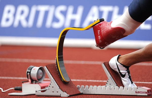 The Cheetah running blade, manufactured by Ossur, in the starting block on an athletics race track
