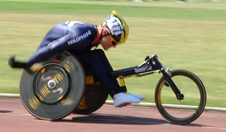 A Bromakin racing wheelchair in action on the track