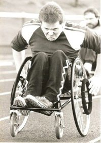 Paul Cartwright competing in wheelchair racing on the athletics track