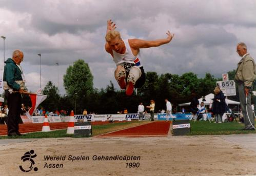 Robert Barrett competing in long jump at the 1990 Para athletics world championships in Assen, Netherlands