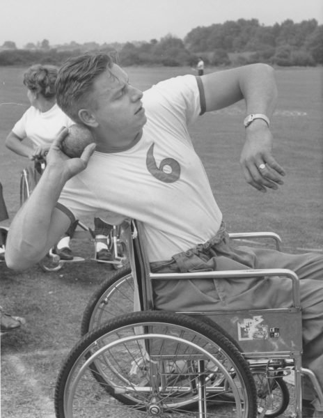 Dick Thompson competing in the shot put at Stoke Mandeville Stadium