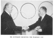 Dr Guttmann receiving the Fearnley Cup from the IOC in 1956, presented by Sir Arthur Porritt