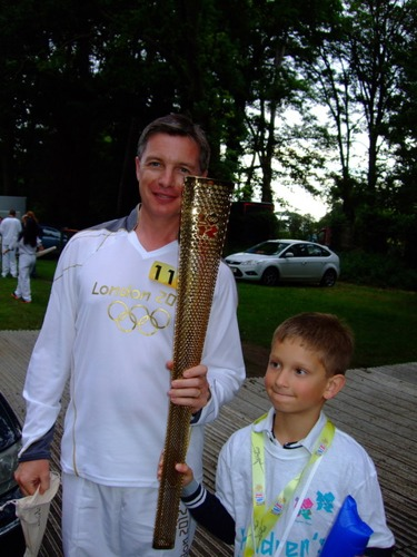 Daniel and his dad, Andy, at evening celebrations of the Torch Relay held in Oxford