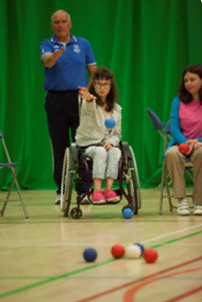 Roy McGee coaching a player in Boccia