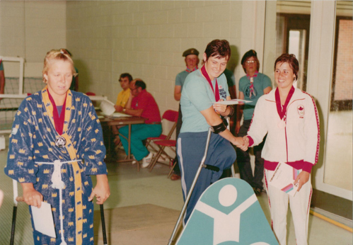 Monica at the medal ceremony for 100m backstroke at the Toronto 1976 Paralympics