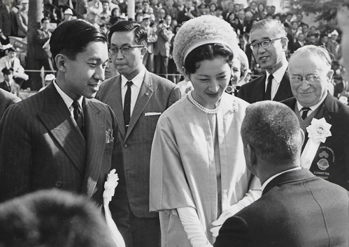 His Imperial Highness Prince Akihito with his wife, Princess Michiko, who were the Games patrons, inspected the teams with Dr Guttmann