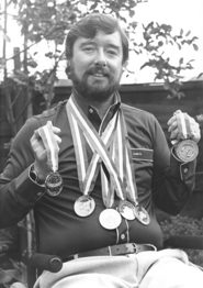 Paralympic swimmer Mike Kenney with his medals.
