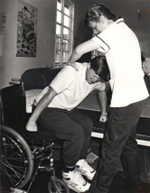 A wheelchair patient having physiotherapy