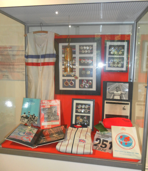 A display of Paul Cartwrights Paralympic medals, sports kit, photos.