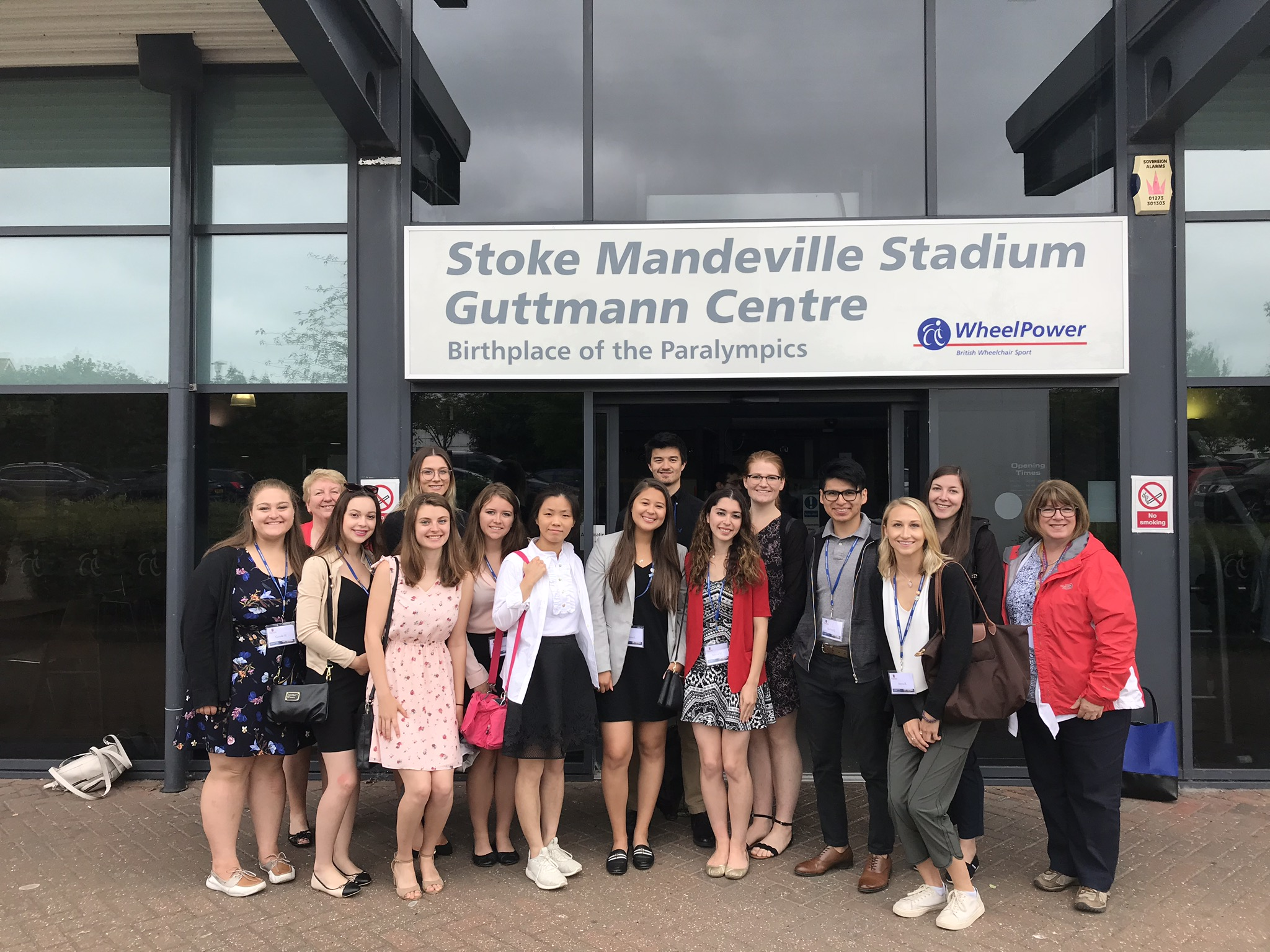 Group photo of the Canadian students visit outside of Stoke Mandeville Stadium
