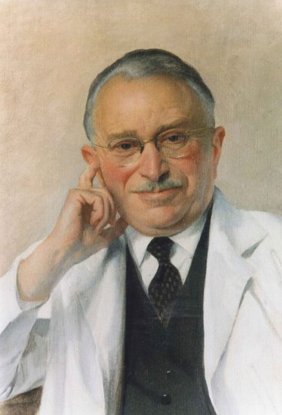 Painting of Dr Guttmann in late middle age wearing a doctors white coat