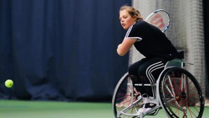 Ruby Bishop competing in Wheelchair tennis