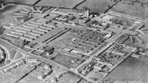 A black and white photography taken from an aeroplane, of Stoke Mandeville Hospital in the 1940s