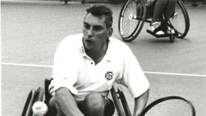 Peter Norfolk at the Japanese Open using an early three-wheel chair for wheelchair tennis in 1998