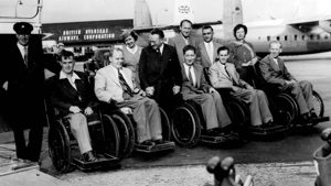 The British team in wheelchairs in front of an aircraft flying out to the Rome games 1960