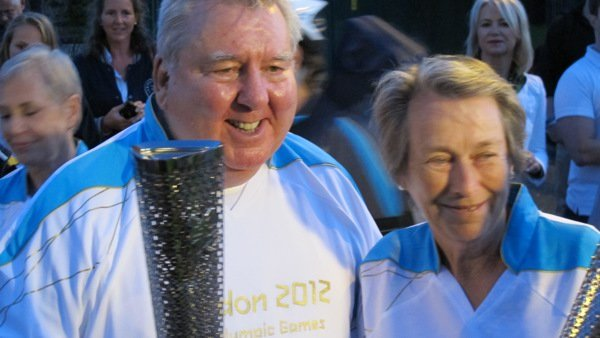 Eva Loeffler and Peter Harrison with the Paralympic Torch at London 2012