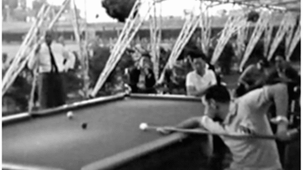 Black and white photograph of snooker players under cover at the 1960 Rome Paralympics