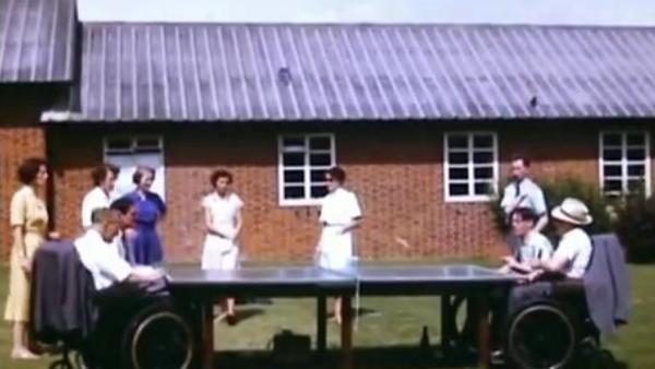 Table tennis being played in wheelchairs; outside the wards at Stoke Mandeville, summer 1955