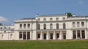 Exterior colour photo of Gunnersbury Park Museum and the surrounding parkland